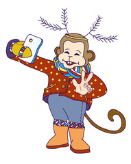 Monkey with deer antlers taking selfie photo on smart phone. Carnival costume as deer antler made of fir branches. Monkey with knitted scarf taking self-portrait and smile