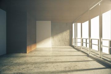 Empty loft style room with concrete floor at sunrise