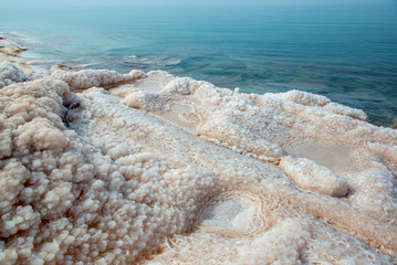 Salt at the Dead Sea beach. Jordan.