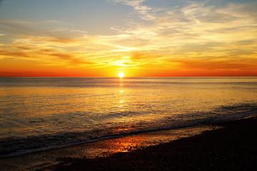 Sun rising over the sea Brighton, England, UK,