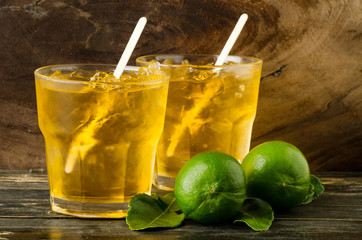 Ice lemon tea on wooden background