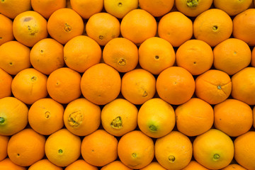 Stack of ripe produce market oranges