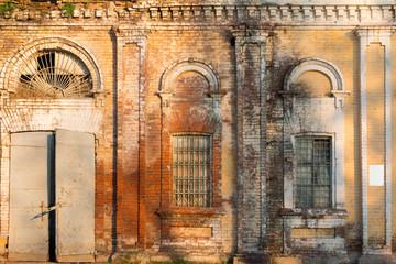 Abandoned industrial building. Old brick warehouse building facade.