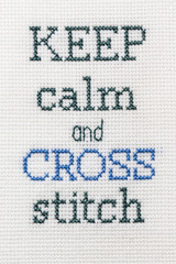 Joke inscription embroidered handmade. Keep calm and cross stitch.