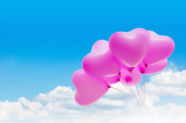 Group of lovely pink heart pattern balloons on clear light blue sky