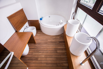 Wooden parquet in contemporary restroom