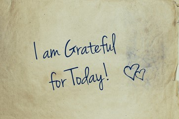 I am grateful for today written on old piece of paper