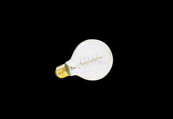 vintage edison light bulb, isolated on black background