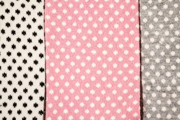 Pink, White and Gray Pair of Child Socks on White Background