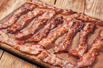 bacon on a wooden plate
