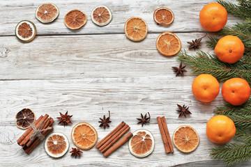 Mandarins with cinnamon, anise and  christmas tree branch