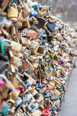 The tradition of leaving pad locks on a bridge to represent love and memories