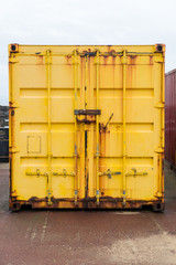 Yellow colored shipping container close up