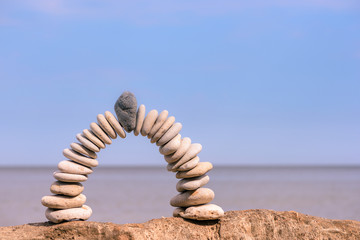 Arch of white pebbles