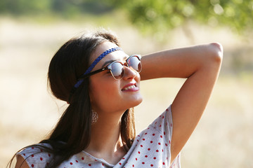 Beautiful woman in sunglasses, outdoors