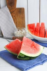 Sliced watermelon on blue cotton napkin