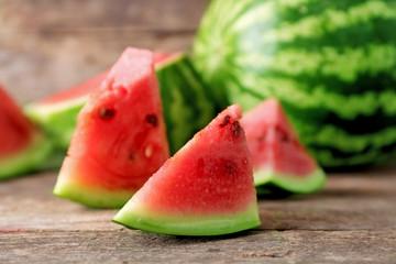 Fresh sliced watermelon wooden background