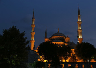 The Blue Mosque illuminated after sunset.  Located in Istanbul, Turkey.  It was completed in 1616 by Sultan Ahmed I..