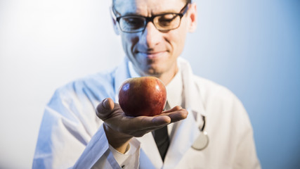 red Apple in the foreground in his outstretched hand doctor