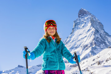 Skier girl with view of Matterhorn on a clear sunny day - Zermatt, Switzerland