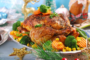 roasted chicken with vegetables on christmas table
