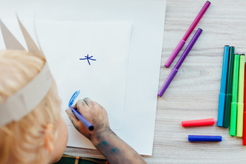 Closeup of child drawing on white paper. Children's Creative Wor