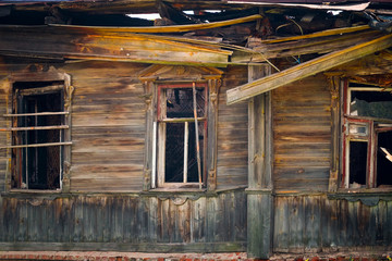 The image of a old wooden house.