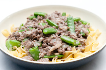 ground beef hamburger stroganoff with chopped snap peas and broa