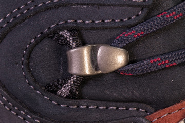 Detail of trekking shoes hook and loop for the strap.