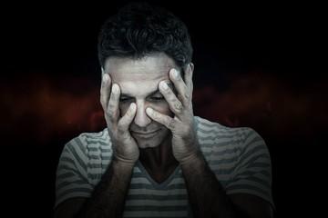 Composite image of upset man with head in hands