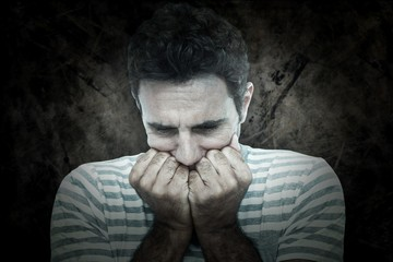 Composite image of upset man with hands on mouth