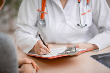 Doctor or physician writing diagnosis