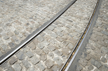 Tracks of the narrow-gauge bonde tram close-up in the cobblestone streets of the Santa Teresa neighborhood in Rio de Janeiro, Brazil