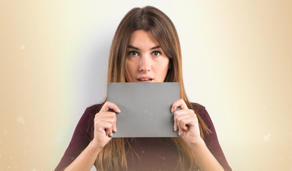 Pretty woman holding an grey placard