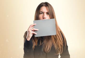 Girl holding an empty placard