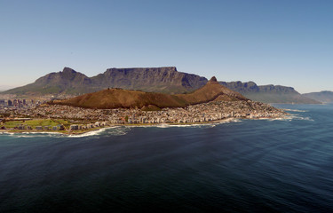 aerial view across the ocean to table mountain, cape town