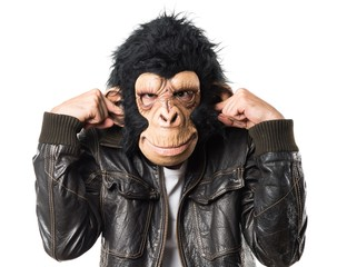 Monkey man covering his ears