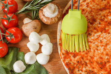 Cooking pizza with fresh vegetables. Food ingredients close up