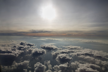 sun and clouds from an airplane window