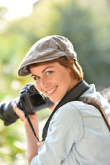 Portrait of cheerful young photographer