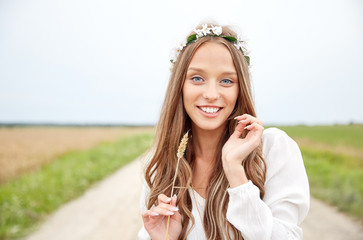 smiling young hippie woman on cereal field