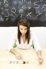 teacher in the classroom on blackboard background