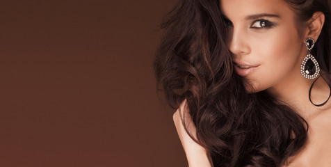Closeup beauty portrait of brunette woman.