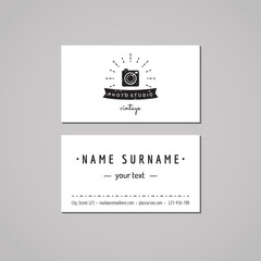 Photo studio business card design concept. Photo studio logo with photo camera, rays and ribbon. Vintage, hipster and retro style. Black and white.