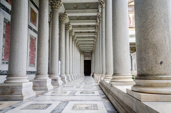 Marble columns in a corridor in the courtyard of the Church of the Basilica of St. Paul's Cathedral Fuori le Mura in Rome, Italy
