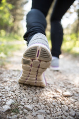 Sport shoes on trail walking in mountains, outdoors activity