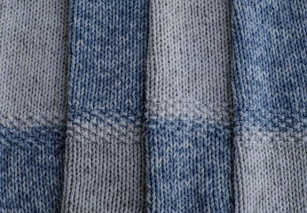 Knitted gray and blue wool pattern close up