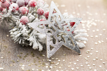Christmas decoration with fir branches on the wood background.