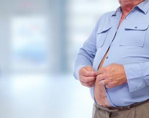 Big fat belly over blue background.
