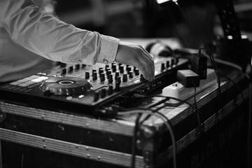 Disc jockey mixing music in the studio